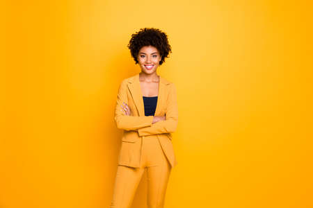 Photo for Portrait of her she nice-looking attractive lovely content cheerful cheery wavy-haired girl folded arms spring clothing trend isolated over bright vivid shine vibrant yellow color background - Royalty Free Image