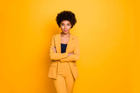 Photo pour Portrait of her she nice-looking attractive charming pretty calm content wavy-haired girl folded arms summer clothing trend isolated over bright vivid shine vibrant yellow color background - image libre de droit
