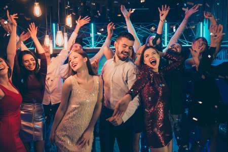 Photo for Photo of dancing people dressed in formalwear rejoicing good free time together with macho surrounded by girls hanging out between them in falling confetti - Royalty Free Image