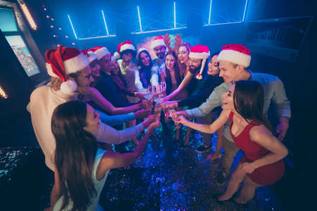 Photo pour High angle view photo of party crowd friends holding sparkling wine glasses counting last seconds to newyear wear dresses shirts pants santa hat in night club - image libre de droit
