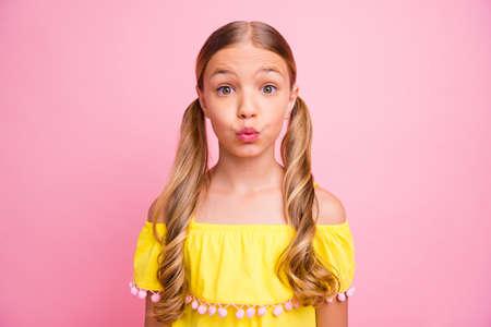 Foto de Photo of beautiful little lady sending air kisses to classmate boy flirty mood wear bright shiny off-shoulders yellow blouse isolated pink color background - Imagen libre de derechos