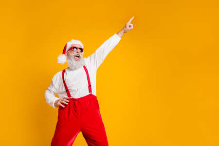 Photo for Portrait of funny crazy santa claus hipster in red hat fun christmas x-mas party celebrate newyear time dance raise index finger wear shirt suspenders isolated yellow color background - Royalty Free Image
