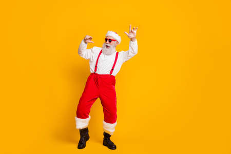 Photo for Christmas party hard clubbing. Full body photo of cool funky santa claus hipster in red hat enjoy newyear tradition celebration dance wear shirt suspenders isolated yellow color background - Royalty Free Image