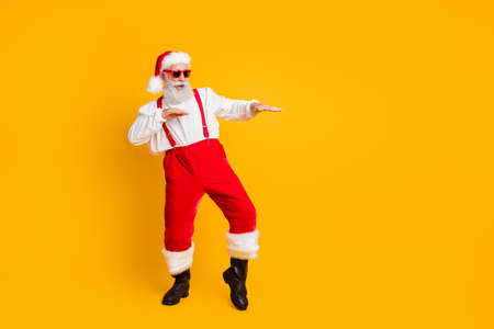 Photo pour Full size photo of funny crazy cool santa claus fairy hipster clubber enjoy x-mas christmas time party dance wear stylish shirt suspenders trousers isolated over yellow color background - image libre de droit