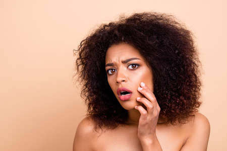 Photo pour Close up photo beautiful amazing she her dark skin model lady oh no facial expression hands arms cheek cheekbone terrible result using cream awful face condition nude isolated pastel beige background - image libre de droit