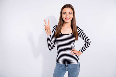 Photo pour Portrait of her she nice attractive shine perfect adorable charming cute lovely pretty cheerful cheery content straight-haired girl showing v-sign isolated over white light background - image libre de droit
