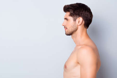 Foto de Close-up profile side view portrait of his he nice attractive content well-groomed calm brunette guy perfect smooth soft skin spa therapy isolated over light white grey color pastel background - Imagen libre de derechos