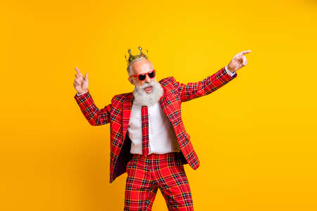 Photo for Photo of cool trendy look grandpa white beard dancing hip-hop strange moves wear crown sun specs plaid red blazer tie pants outfit isolated yellow color background - Royalty Free Image