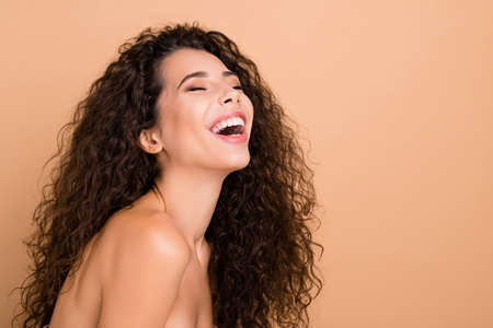 Photo pour Close up side profile photo beautiful amazing she her model lady ideal appearance eyes closed laughing pure silky skin condition sincere slim skinny wear no clothes isolated beige pastel background - image libre de droit