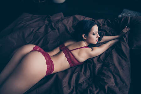Photo for Close up back rear behind view photo beautiful desire tender she her lady wife perfect ideal shapes skin surprise wish want husband touches lying sheets nude red bikini boudoir room indoors bedroom - Royalty Free Image