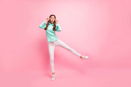 Photo for Full body photo of funny lady walking down street stopped motion staring beautiful sight wear specs turquoise shirt white trousers isolated pink color background - Royalty Free Image