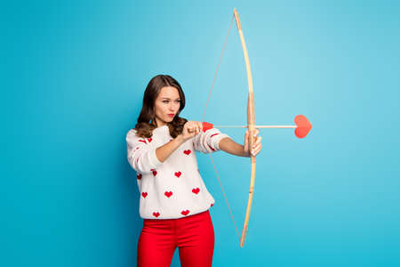 Photo pour Portrait of her she nice-looking attractive lovely charming pretty cute focused girl shooting sending amorous arrow isolated on bright vivid shine vibrant blue color background - image libre de droit