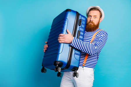 Photo pour Portrait of serious man bad moody hold heavy luggage he prepare for voyage weekend tourism resort airport wear good look vest isolated over blue color background - image libre de droit