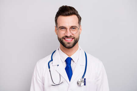 Photo pour Close-up portrait of his he nice attractive smart clever cheerful cheery doc professor emergency center owner director ceo boss chief isolated on light white gray pastel color background - image libre de droit