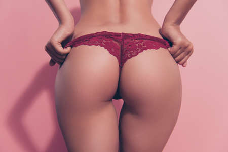 Photo pour Cropped close-up rear back behind view of nice thin fit babe lady girlfriend wife posing perfect flawless round sportive curvy line figure erotica putting panties off isolated over pink background - image libre de droit