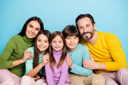 Photo pour Close-up portrait of nice attractive careful affectionate friendly ideal cheerful cheery adorable family embracing enjoying holiday isolated on bright vivid shine vibrant blue color background - image libre de droit
