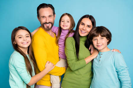 Photo pour Close-up portrait of nice attractive lovely perfect tender sweet glad cheerful cheery family schoolkids mom dad embracing spending day isolated on bright vivid shine vibrant blue color background - image libre de droit
