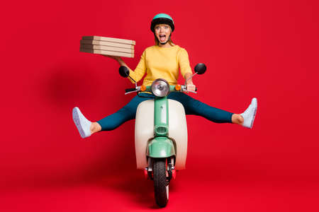 Photo for Portrait of her she nice attractive careless girlish cheerful cheery girl riding moped without legs having fun carrying pile stack bakery isolated on bright vivid shine vibrant red color background - Royalty Free Image