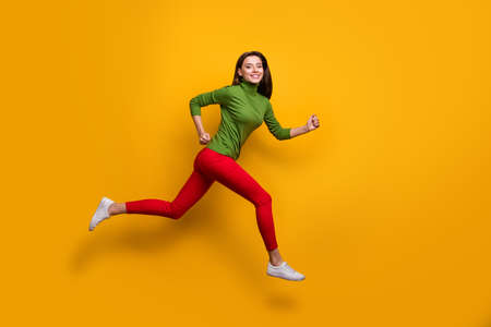 Photo for Full size photo of positive cheerful girl jump run fast after black friday sales wear casual style clothes white sneakers isolated over vibrant color background - Royalty Free Image