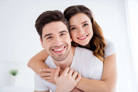 Photo for Closeup photo of adorable lady cheerful handsome guy married couple in love enjoy weekend saturday morning good excited mood hugging hold hands wear pajama room indoors - Royalty Free Image