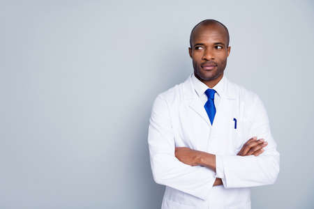Photo for Photo of curious doctor dark skin guy virologist agent corona virus arms crossed pandemic virus expert look empty space interested wear white lab coat tie isolated grey color background - Royalty Free Image