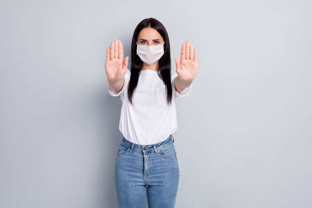 Photo pour Portrait of nice attractive content serious straight-haired girl showing stop sign solution health quarantine measure contact clean wash hands isolated on light grey pastel color background - image libre de droit