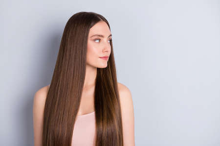 Photo pour Profile photo of pretty charming lady not smiling presenting ideal neat long hairstyle look empty space wear beige singlet isolated grey color background - image libre de droit