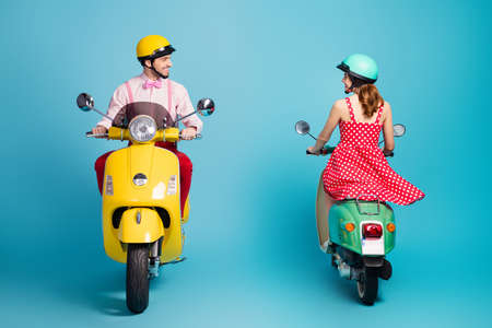 Photo pour Full size back rear spine photo of positive man ride motor bike chopper look pretty coquettish flirty redhair girl motorcyclist want have date isolated over blue color background - image libre de droit