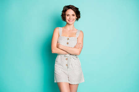 Photo for Photo of funny cheerful lady good mood arms crossed self-confident person wear casual summer white dotted short overall isolated pastel teal color background - Royalty Free Image