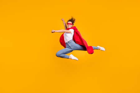 Photo for Full length body size view of her she nice attractive lovely fit slim cheerful cheery girl jumping wearing cape rescuing planet isolated on bright vivid shine vibrant yellow color background - Royalty Free Image