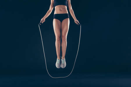 Foto per Cropped view of her she nice attractive sportive slim thin slender strong lady working out dream purpose figure correction perfection isolated over black background - Immagine Royalty Free