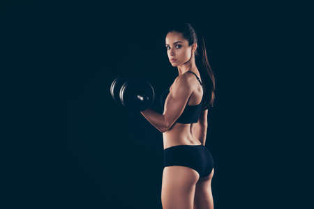 Photo pour Portrait of gorgeous lady hold hand sports equipment want be slender isolated over black background - image libre de droit