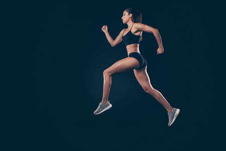Photo for Full size profile photo short sport suit lady sprint run jogger inspired to win race first place member isolated black background - Royalty Free Image