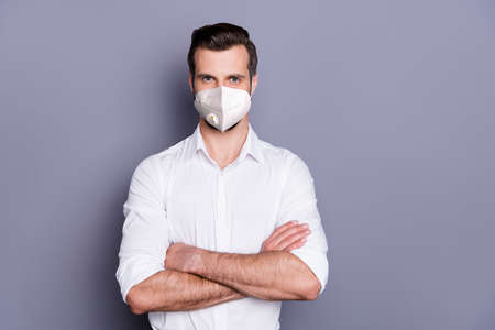 Photo pour Portrait of attractive healthy content virile macho guy agent broker medic wearing safety n95 mask folded arms mers cov infection pandemia stay home isolated over gray color background - image libre de droit