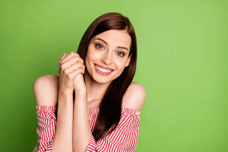 Photo pour Photo of cute adorable student girl look camera smiling thankful appreciate guy help repare computer wear striped white red blouse uncovered shoulders bright green color background - image libre de droit