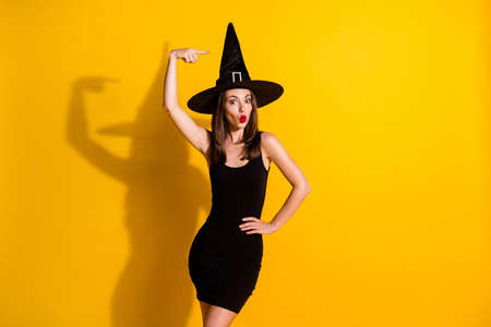 Foto de Portrait of her she nice-looking attractive pretty lovely funny amazed lady wizard wearing cone hat demonstrating pout lips having fun isolated on bright vivid shine vibrant yellow color background - Imagen libre de derechos