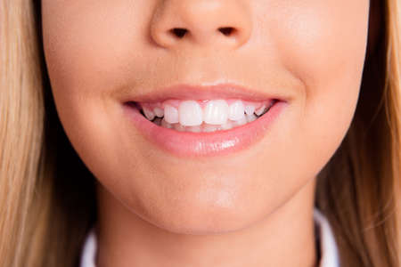 Photo pour Close up cropped photo of charming lovely schoolgirl little lady mouth pink balm shiny toothy white smile teeth hygiene dentist clinic promo healthy oral care disease prevention concept - image libre de droit