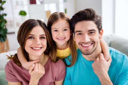 Photo pour Close up photo of loving tender gentle family mother father and small kid girl cuddle hug embrace in house indoors - image libre de droit