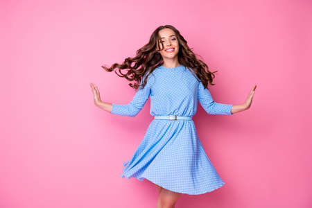 Photo pour Portrait of nice-looking attractive lovely pretty adorable exquisite delicate cheerful cheery wavy-haired lady spinning dancing good mood isolated over pink pastel color background - image libre de droit
