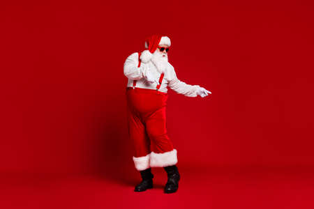 Photo pour Full length body size view of his he attractive cool funny fat white-haired Santa dancing having fun chill rest relax isolated bright vivid shine vibrant red burgundy maroon color background - image libre de droit