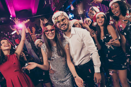 Photo pour Photo of positive people man embrace charming girl toothy smile camera deer x-mas glasses modern club indoors - image libre de droit