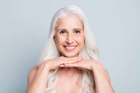 Photo pour Close-up portrait of her she nice attractive cheery grey-haired elderly lady pure soft skin therapy isolated on light gray pastel color background - image libre de droit