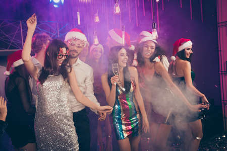 Photo pour Photo of people party bearded man dance with girl rejoice wear glossy dress santa spectacles cap stylish outfit modern club indoors - image libre de droit