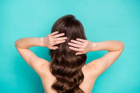 Foto de Closeup back rear behind view photo of beautiful lady curly long hairstyle touch hands perfect long curls styling preparing date nude shoulders isolated bright teal color background - Imagen libre de derechos