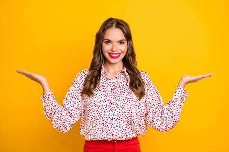 Photo pour Photo of pretty lady beaming smile two hands palms hold comparing proposition isolated on yellow color background - image libre de droit