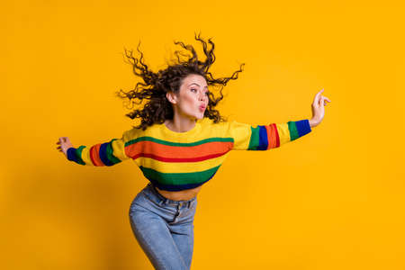 Photo for Photo of childish lady wearing casual colorful sweater dancing looking pointing empty space lips pouted isolated yellow color background - Royalty Free Image