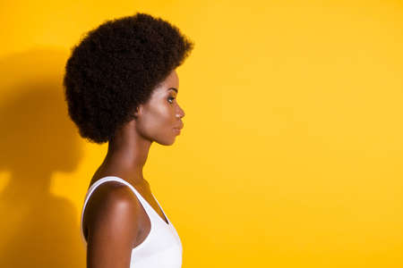 Photo pour Close-up profile side view view portrait of charming content wavy-haired girl copy space isolated over bright yellow color background - image libre de droit