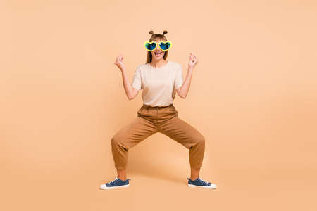Photo for Full length photo of girl dance childish dance wear eyewear t-shirt pants sneakers isolated beige color background - Royalty Free Image
