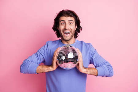 Photo for Photo of young handsome crazy excited positive good mood cheerful man hold disco ball isolated on pink color background - Royalty Free Image
