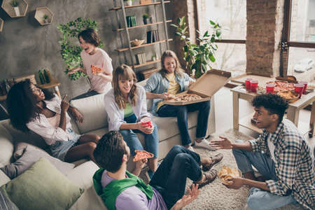 Photo for Photo portrait of students sitting in room talking at party eating pizza drinking beer communicating - Royalty Free Image